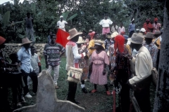 Rara Queen and Kings receive instruction on how to dance before the ancestors at the cemetary