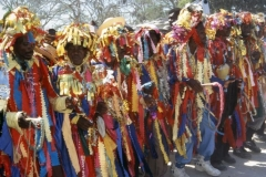 Rara band in cloth strip costume, in the style of the Artibonite Valley.