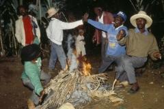 Rara leaders do spiritual work over a bonfire